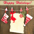 Blank sheet with Christmas decor hanging on grey wooden wall — Stock Photo