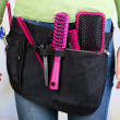 Womhairdresser with tool belt on bright background — Stock Photo #38596161