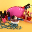 Cosmetics on yellow background — Stock Photo
