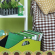 Stock Photo: Magazines and folders in green box on floor in room