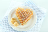 Sweet Belgium waffles with banana, isolated on white — Stock Photo