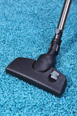 Vacuuming carpet in house — Stock Photo