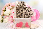 Romantic still life with heart in wooden casket — Stock Photo