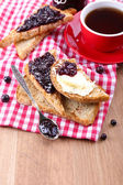 Delicious toast with jam on table close-up — Stock Photo