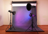 Photo studio with lighting equipment — Stock Photo