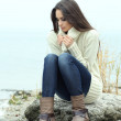 Portrait of young serious woman near river — Stock Photo