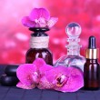Beautiful spa setting with orchid on bamboo table on red background — Stok fotoğraf