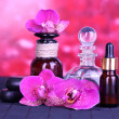 Beautiful spa setting with orchid on bamboo table on red background — Stock fotografie