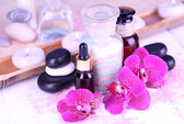 Beautiful spa setting with orchid on white wooden table close-up — ストック写真
