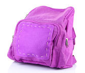 Purple backpack supplies isolated on white — Stock Photo