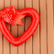Decorative heart, on wooden background — Stock Photo