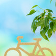 Stock Photo: Decorative bicycle on grass on bright background