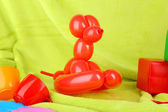 Simple balloon animal dog, on bright background — Stock Photo