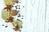 Herbs and spices border, on wooden background — Stockfoto