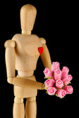 Wooden mannequin holding bouquet on gray background — Stok fotoğraf