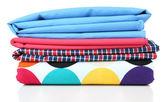 Pile of colored fabrics isolated on white — Stock Photo