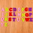 English alphabet on wooden background — Stock Photo