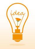Flower growing inside light bulb on light background — Stock Photo