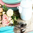 Lots beautiful dishes on wooden table close-up — Stock Photo #38787589