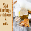 Honey and milk spa with oils and honey on wooden table close-up — Stock Photo #38788097