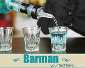 Barmen hand with bottle pouring beverage into glasses, on bright background — Stock Photo