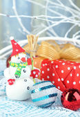 Beautiful Christmas composition with gift and Christmas toys close-up — Foto Stock