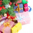 Decorated Christmas tree with gifts, close up, isolated on white — Stock Photo #38815855