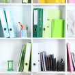 White office shelves with folders and different stationery, close up — Stock Photo #38811727