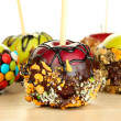 Stock Photo: Candied apples on sticks on wooden table close up