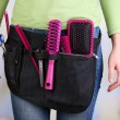 Womhairdresser with tool belt on bright background — Stock Photo #38815449