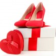 Beautiful red female shoes and gift box, isolated on white — Stock Photo