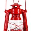 Stock Photo: Red kerosene lamp isolated on white