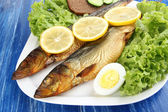 Smoked fish on plate close up — Stock Photo