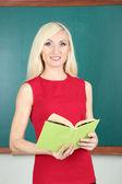 School teacher near blackboard close-up — Stock Photo