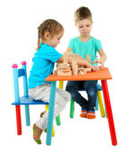 Little children playing with building blocks isolated on white — Stock Photo