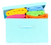 Textile box with bright towels, isolated on white — Stock Photo