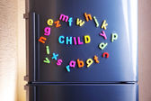 Word Child spelled out using colorful magnetic letters on refrigerator — Stock Photo