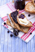 Delicious toast with jam on table close-up — Photo