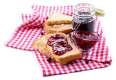 Delicious toast with jam isolated on white — Photo