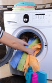 Washing machine loaded with clothes close-up — Stok fotoğraf