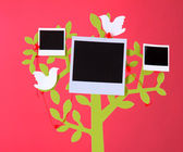 Holder in form of tree with instant photo cards on dark color background — Stockfoto