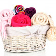 Warm knitted scarves in basket isolated on white — Stock Photo #38823331