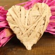 Decorative straw for hand made and heart of straw, on wooden background — Stock Photo #38823731
