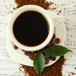 Cup of coffee with instant coffee on wooden background — Stock Photo