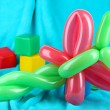 Simple balloon animal dragonfly, on bright background — Stock Photo #38824171