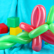 Simple balloon animal dragonfly, on bright background — Stock Photo