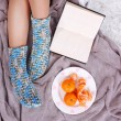 Female legs in colorful socks on color background — Stock Photo