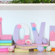 Shelf decorated with handmade knit letter — Stock Photo #38825255