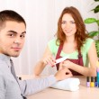 Stock Photo: Beautiful girl manicurist doing manicure for min beauty salon