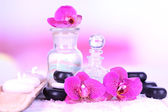 Beautiful spa setting with orchid on white wooden table on bright background — Stock fotografie